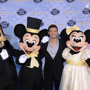 "19 of 19: The American Idol Experience - Television and radio personality Ryan Seacrest, the host of the hit TV show ""American Idol,"" poses Feb. 12, 2009 with Goofy, Mickey Mouse and Minnie Mouse during the grand opening of ""The American Idol Experience"" attraction at Disney's Hollywood Studios. Photo Copyright The Walt Disney Company 2009."