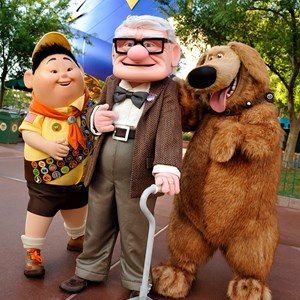 1 of 1: The Magic of Disney Animation - UP Meet and Greet characters - Russell, an eight-year-old Wilderness Explorer, Carl Fredricksen, a 78-year-old balloon salesman and Dug, a dog. Copyright 2009 The Walt Disney Company.