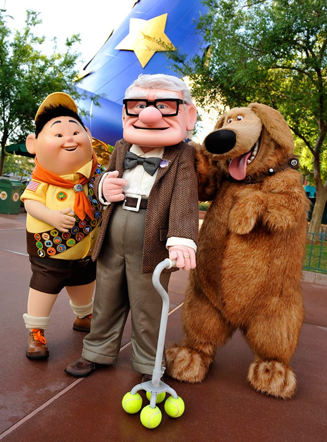 The Magic of Disney Animation - UP Meet and Greet characters - Russell, an eight-year-old Wilderness Explorer, Carl Fredricksen, a 78-year-old balloon salesman and Dug, a dog. Copyright 2009 The Walt Disney Company.
