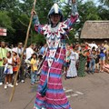 The Taste of Africa Street Party - Stilt walkers and dancers begin the party