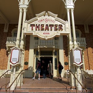 1 of 9: Town Square Theater - The entrance area with the two FASTPASS clocks on either side