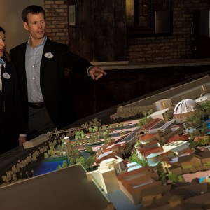 7 of 7: Disney Springs - Meg Crofton, and Tom Staggs look over the model of the Disney Springs expansion