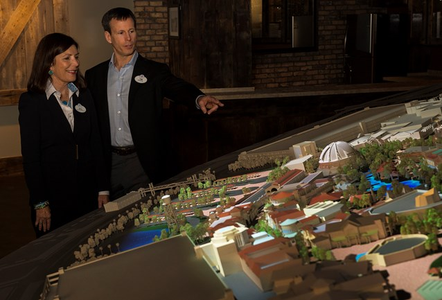 Disney Springs - Meg Crofton, and Tom Staggs look over the model of the Disney Springs expansion