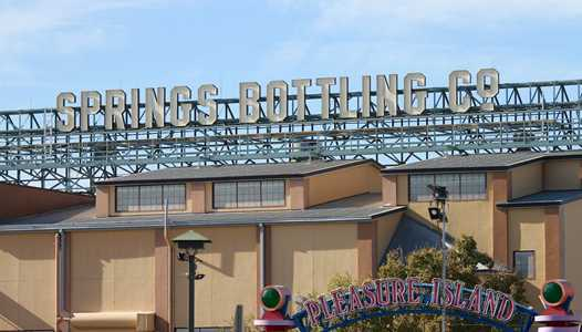PHOTOS - Springs Bottling Co signage now up at Disney Springs