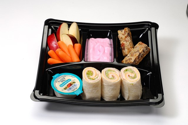 A Taste of Hollywood To Go – A Fantasmic Dining Experience - Kid's meal with turkey and American cheese wrap and strawberry yogurt, apples and carrots with ranch dip and seven-layer cookie bar ($5.49)