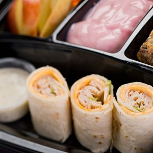4 of 7: A Taste of Hollywood To Go – A Fantasmic Dining Experience - Turkey and American cheese wrap with apples and carrots with Ranch dip, strawberry yogurt and a seven-layer cookie bar available with Fantasmic! Seats at Disney's Hollywood Studios