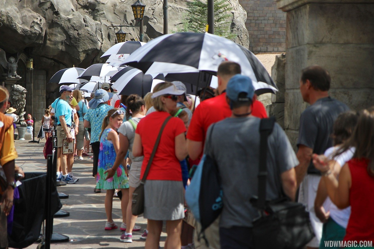 Be Our Guest Restaurant summer queue umbrellas