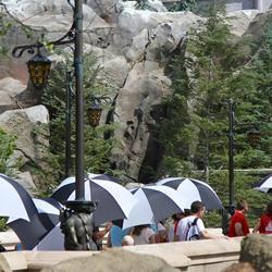 Be Our Guest Restaurant summer queue umbrellas