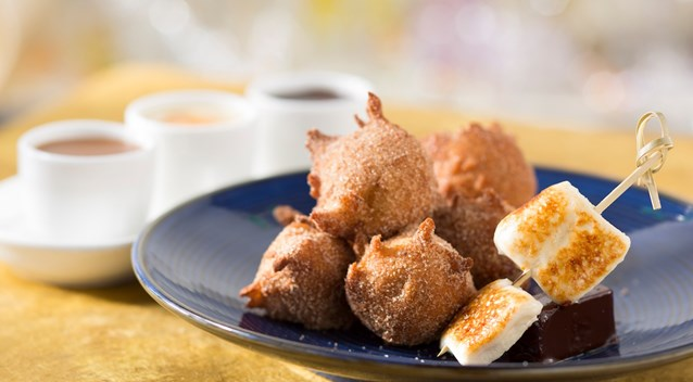 California Grill - New California Grill menu - Warm homemade banana fritters dusted with sugar and cinnamon and served with toasted caramel marshmallow and a trio of dipping sauces – peanut butter, salted caramel and chocolate