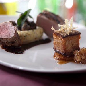 11 of 20: California Grill - New California Grill menu - California Grill Pork Two Ways includes grilled tenderloin with creamy goat cheese polenta and mushrooms, and lacquered pork belly with house made applesauce