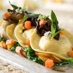 14 of 20: California Grill - New California Grill menu - Roasted squash ravioli with root spinach, parsnips, petite herb salad, sage brown butter and 12-year balsamic
