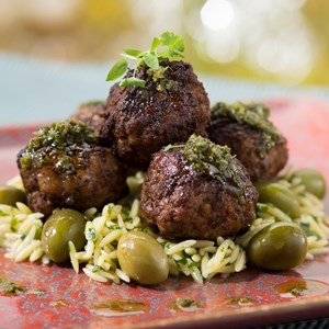15 of 20: California Grill - New California Grill menu - From the California Grill wood-burning oven, Three-Meat Signature Meatballs with picholine olives, herbed orzo, chimichurri and lavender mint