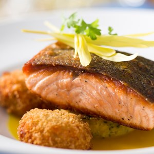 16 of 20: California Grill - New California Grill menu - Wild Columbia River salmon with southern sweet corn pudding, crisp salmon cakes and spice saffron broth