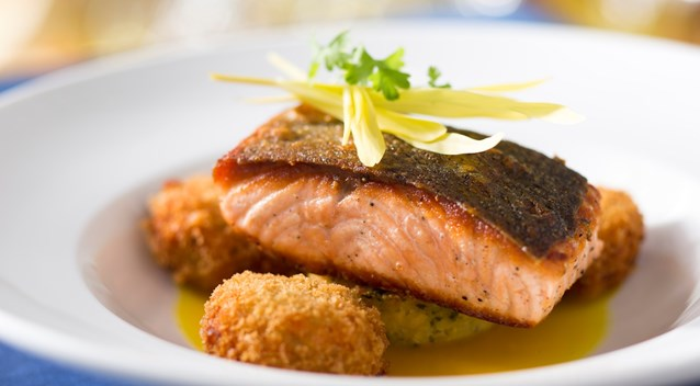 California Grill - New California Grill menu - Wild Columbia River salmon with southern sweet corn pudding, crisp salmon cakes and spice saffron broth