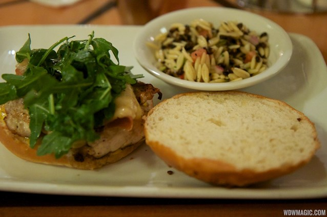 Captain's Grille - Captain's Grille - Grilled Chicken Sandwich Prosciutto, Aged Vermont Cheddar, and Arugula Salad on a House-made Onion Roll with Vegetable Orzo Salad