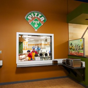 13 of 20: End Zone Food Court - New All Star Sports End Zone Food Court - Pizza pickup window