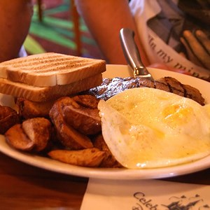 3 of 3: Kona Cafe - Steak and Eggs - New York Strip Steak served with two eggs, Home-Fried Potatoes, and a biscuit or toast