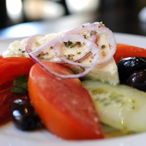 3 of 10: Kouzzina by Cat Cora - SPIRO'S GREEK SALAD: The traditional starter at Kouzzina by Cat Cora at Disney's BoardWalk Resort includes tomatoes, cucumbers, red onions, kalamata olives and feta. Copyright 2009 The Walt Disney Co.