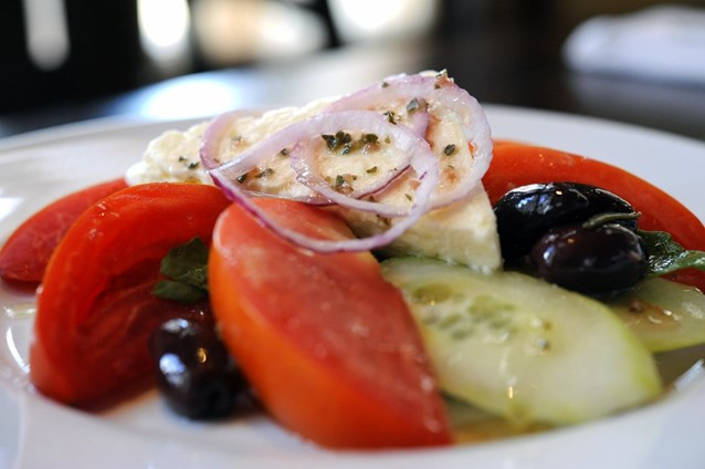 Kouzzina by Cat Cora - SPIROS GREEK SALAD: The traditional starter at Kouzzina by Cat Cora at Disneys BoardWalk Resort includes tomatoes, cucumbers, red onions, kalamata olives and feta. Copyright 2009 The Walt Disney Co.