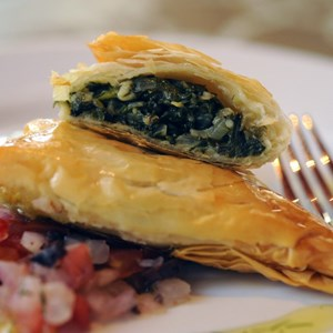 4 of 10: Kouzzina by Cat Cora - SPANAKOPITA: The version of this savory pie at Kouzzina by Cora at Disney's BoardWalk Resort has a flaky phyllo crust and a filling of spinach, feta, leeks and dill. Copyright 2009 The Walt Disney Co.