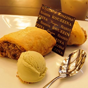 9 of 10: Kouzzina by Cat Cora - LAVA: This traditional walnut and cinnamon pastry is served with pistachio gelato at Kouzzina by Cat Cora at Disney's BoardWalk Resort. Copyright 2009 The Walt Disney Co.