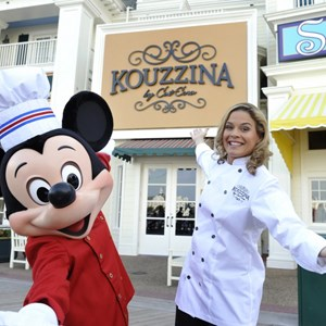 1 of 2: Kouzzina by Cat Cora - Cat Cora and Mickey Mouse at the grand opening of Kouzzina by Cat Cora. Copyright 2009 The Walt Disney Co.