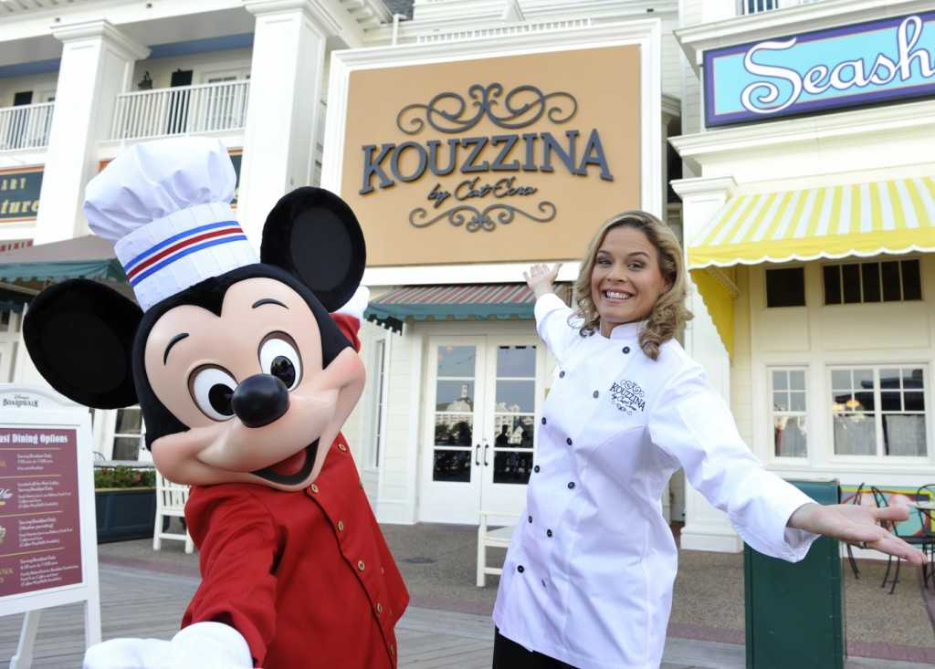 Cat Cora and Mickey Mouse at the grand opening of Kouzzina by Cat Cora. Copyright 2009 The Walt Disney Co.