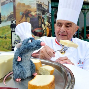 "1 of 1: Les Chefs de France - Famed French Chef Paul Bocuse greets a new Audio-Animatronics figure named ""Remy"" at Les Chefs de France restaurant at Epcot. Copyright 2009 The Walt Disney Company."
