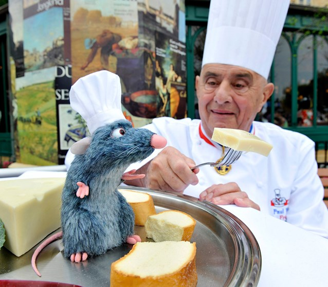 "Chefs de France - Famed French Chef Paul Bocuse greets a new Audio-Animatronics figure named ""Remy"" at Les Chefs de France restaurant at Epcot. Copyright 2009 The Walt Disney Company."