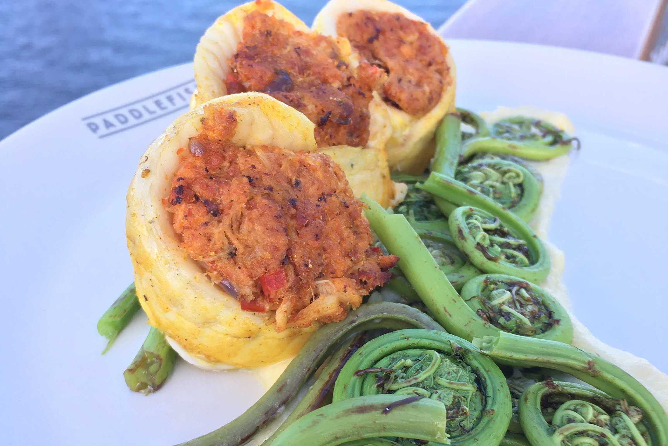 Paddlefish Easter Special - Dover Sole Roulades (Crab and chourico stuffed, fiddlehead ferns atop mango beurre blanc)
