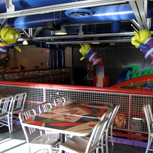 3 of 8: Pizza Planet - Pizza Planet dining areas and arcade