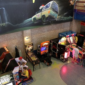6 of 8: Pizza Planet - Pizza Planet dining areas and arcade