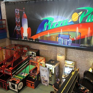7 of 8: Pizza Planet - Pizza Planet dining areas and arcade