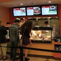 Pollo Campero - Overhead screens display the menu options