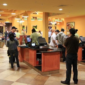 7 of 12: Pollo Campero - The registers - you pay after picking up your food and drinks from the counters. The bakery kiosk is visible at the rear.