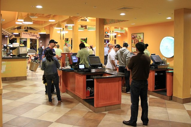 Pollo Campero - The registers - you pay after picking up your food and drinks from the counters. The bakery kiosk is visible at the rear.