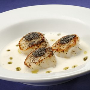 2 of 9: Sanaa - Mustard seed-crusted Scallops with a coconut cream suace.