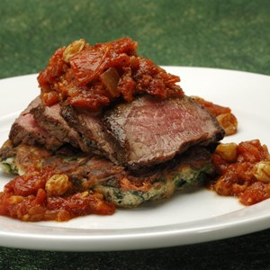 4 of 9: Sanaa - Grilled Flank Steak, with spinach and mushroom pancake served with oven-dried chutney.