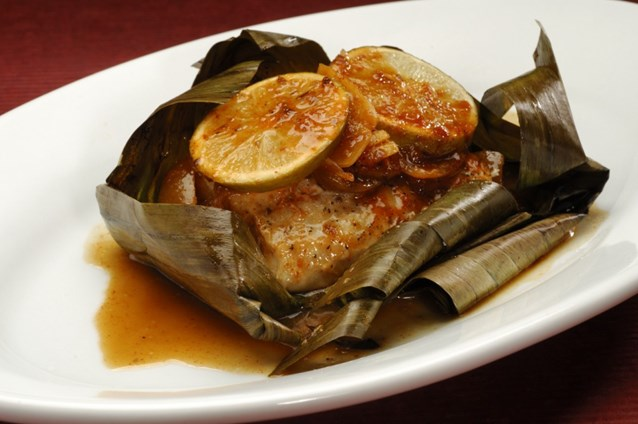 Sanaa - Banana Leaf-wrapped Sustainable Fish with ginger and pickled lime served with basmati rice or seven grain pilag.
