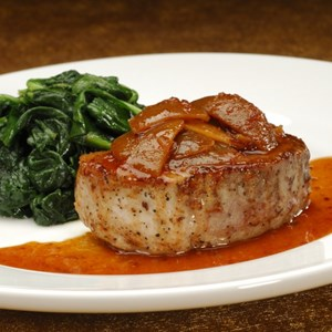9 of 9: Sanaa - Grilled Pork Chop Loin, glazed with pickled lime and ginger served with sauteed spinach.