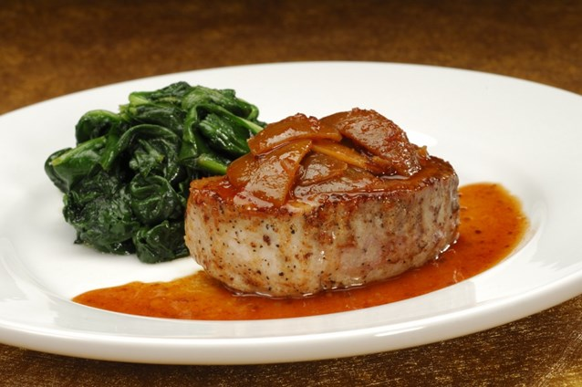 Sanaa - Grilled Pork Chop Loin, glazed with pickled lime and ginger served with sauteed spinach.