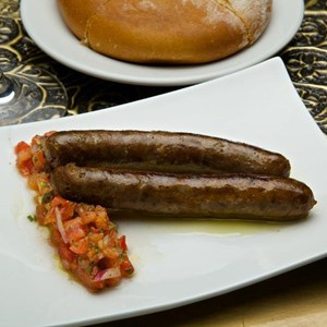 7 of 15: Spice Road Table - Spice Road Table food - Moroccan Mergues Sausage