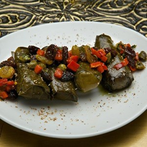 9 of 15: Spice Road Table - Spice Road Table food - Rice Stuffed Grape Leaves
