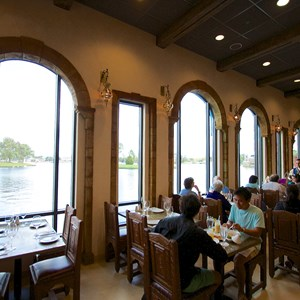 7 of 26: Spice Road Table - Spice Road Table - Indoor dining room overlooking World Showcase Lagoon