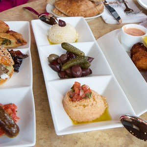 15 of 26: Spice Road Table - Spice Road Table - Tingis Sampler $16, Hummus and Imported Olives $10, Salted Cod Croquettes $10