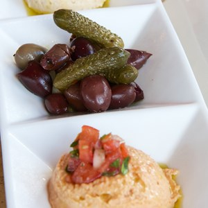 18 of 26: Spice Road Table - Spice Road Table - Imported Olives and Hummus $10