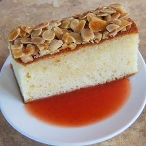 26 of 26: Spice Road Table - Spice Road Table - Almond and Rosewater Cake with blood orange sauce $7