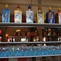 Via Napoli - Glassware and drinks rack on display