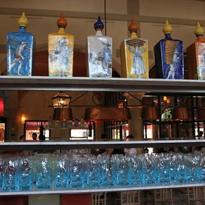 15 of 44: Via Napoli - Glassware and drinks rack on display