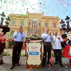 1 of 2: Via Napoli - VIA NAPOLI: (L-R) Mickey Mouse; Dan Cockerell, Vice President of Epcot; Clay Shoemaker, Walt Disney World Ambassador; Nick Valenti, CEO of Patina Restaurant Group; Joachim Splichal, Founder and Chairman of Patina Restaurant Group; and Minnie Mouse celebrate Aug. 5, 2010 during the grand opening of Via Napoli in the Italy pavilion at Epcot World Showcase. Via Napoli, operated by Patina Restaurant Group, features wood-burning ovens – and will use water from a source that most resembles the water in Naples, Italy, home of some of the world's best pizza dough. The 300-seat pizzeria features a menu inspired by the famous pizzerias of southern Italy. The menu also features pastas, salads, sandwiches and Italian wines. (Gene Duncan, photographer)